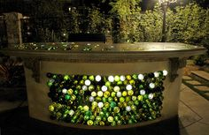 """Outdoor bar made with recycled wine bottles.love the way the light shines through. """"Serenity in the Garden: Repurposed and Recycled - Creative Ideas for Garden Design"""" Empty Wine Bottles, Recycled Wine Bottles, Wine Bottle Crafts, Glass Bottles, Beer Bottles, Recycled Glass, Wine Bottle Wall, Wine Wall, Soda Bottles"""