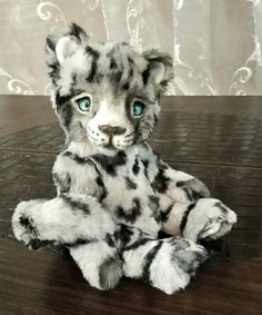 Snow leopard Simon By Kirichenko Irina - Snow leopard Simon. Sewn from gorgeous fur,very soft and fluffy.Tinted with oil paints.All connections are movable on the pins.Inside padding polyester and metal granulate.Eyes glass handmade.The tail is reinforced.The muzzle is hand-made from cardoons.Simon has whiskers from fishing li...