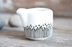 """milk jug """"somewhat angular"""", hand-painted, black and white"""