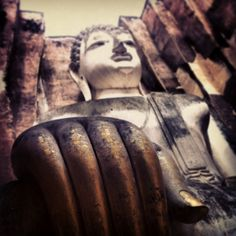 The famous buddha of Sukhothai, Thailand National Park with gold leaf hands from prayers