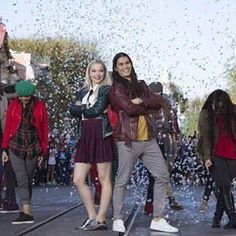 Dove Cameron and Booboo Stewart in the descendants holiday celebration in Disney parks get ready for d2