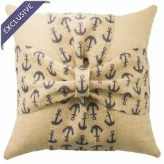 """Showcasing a charming anchor-print bow detail, this handcrafted burlap pillow offers nautical-inspired appeal for your bed or favorite reading nook. Made in the USA.   Product: PillowConstruction Material: Burlap cover and fiber fillColor: Beige and navyFeatures:  Insert includedZipper closureMade in the USAHandmade by TheWatsonShop exclusively for Joss & MainNautical-inspired  Dimensions: 16"""" x 16""""Cleaning and Care: Spot clean"""
