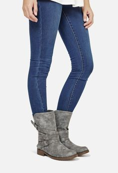 Cozy up, girl. There's cooler temperatures up ahead, and with this strap and buckle faux leather boot you'll be set for fall.  ...