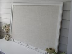 Bulletin Board - Deluxe Cottage Magnet Board X-Large - Framed Magnetic Memo Board with Handmade Wood Frame and Ivory Burlap and Glass Knobs. $229.00, via Etsy.