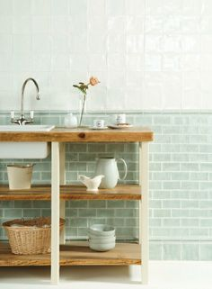 Lovely tile placement and tiles. I really like the idea of recreating a skirting board detail with tile.