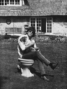 Keith Richards at home with his dog, Ratbag,1966.