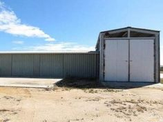 PRIME LOCATION - 2 SHEDS + DEVELOPMENT POTENTIAL ON 2.14HA - Large partly fenced block with Highway frontage 2 Sheds on the property with 3 Phase power Bathroom facilities on site with a 60 person Sanitary sys... Commercial Property For Sale, Sheds, Outdoor Structures, Bathroom, Outdoor Decor, Shed Houses, Washroom, Shed, Full Bath