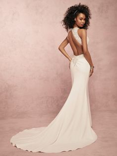 Delores by Rebecca Ingram Chic and flattering, this wedding dress features a bodice accented in lace motifs over a crepe sheath skirt.  Complete with halter neckline and keyhole back trimmed in lace motifs.