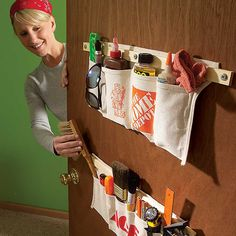Tool-Apron Storage - Tool aprons can be modified to store nearly any household item. Just sew a variety of pocket widths in the aprons, then mount the aprons by screwing a wood strip through the top of each and into a door. For hollow-core doors, use hollow anchor fasteners to hold the screws firmly to the door.