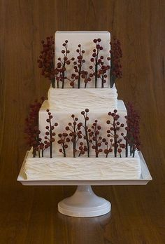 Winter means bare, rustic trees, an image that this Elegantly Iced cake reflects with its red and brown branches. See more rustic wedding cakes.