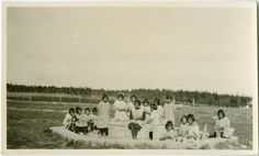 United Church of Canada Archives - Digital Collections | Little girls making mud pies in the sandbox at the Indian Boarding School, Norway House