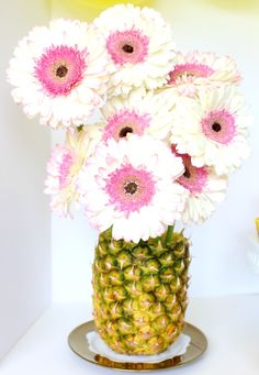 Need a new vase idea? what about a pineapple! weird... but great.