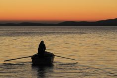 COLOR GRADIENT: A fisherman rowed a boat during sunset in Lun, Croatia, Wednesday. (Antonio Bronic/Reuters)