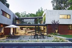 contemporary courtyard with glass bridge element