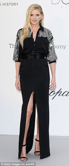 Simple: Veteran model Lara Stone opted for a unique black and silver number to make the mo...