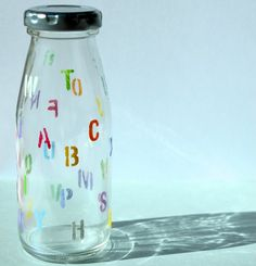 Nostalgic milk bottle Colorful letters of the alphabet Let add a little playful desk https://c5.staticflickr.com/9/8662/29396295244_081699d1ab.jpg  &q...