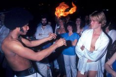 A man performs with fire at the disco club Infinity in New York City, 1979.
