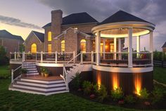 If you've got a decent amount of yard space, you've probably thought of a few deck ideas for your home. Decks, like patios, can be used as outdoor Casas Country, Outdoor Deck Lighting, Landscape Lighting, Tiered Deck, Gazebos, New England Homes, Decks And Porches, Deck Design, Backyard Patio
