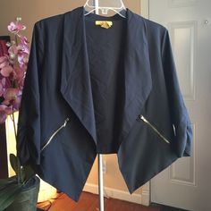Cropped Blazer Black cropped jacket with zip up pockets. No rips or stains. 90% polyester 10% spandex. Please excuse the wrinkles. I will take care of that before shipping  Jackets & Coats