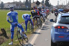 CYCLISTS STOP FOR A CALL OF NATURE IN THE 2009 MILAN SAN REMO