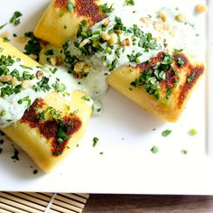 Goat Cheese and Zucchini Blintzes with Cilantro Cream Sauce -  Jewish food and recipes - #Shavuot