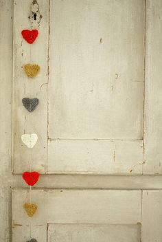 This is kind of a cool idea. You could use fabric hearts... or really... whatever kind of hearts. And just put them on a wire or string and hang at your leisure. :) Lightweight = no worries on hanging just about anywhere in your dorm room.