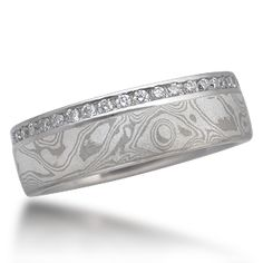 Mokume Diamond Side Channel Wedding Band - This is a mokume wedding band and a diamond eternity ring in one. Designed for men, but great for women also. A most unusual combination. Priced for 1.5 mm ideal cut diamonds, but the stones can be scaled up or down with the width of the ring.