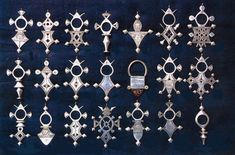 The 21 Crosses of the Tuareg People, Niger. Originally worn by men, now also worn by women,and passed down from father to son when the boy reached puberty. Most of the cross designs are named after oasis towns or mountains between Agadez in Niger and the Hoggar Mountains in the north.