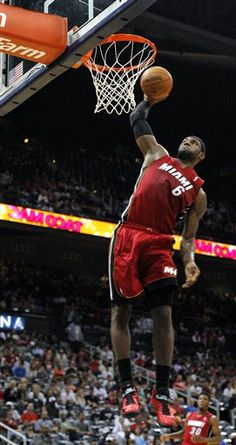 Miami Heat forward LeBron James (6) dunks in the first half of a preseason NBA basketball game against the Atlanta Hawks, Sunday, Oct. 7, 2012, in Atlanta.