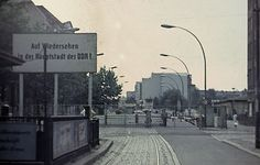 """A sign reading """"Come back to the capital of GDR"""""""