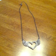 Heart With Wings Silver Necklace  Heart with wings silver necklace in EUC. All stones in tact, but it needs a new hook or new chain. Sad to see this go, but I have too much jewlery!! Hot Topic Jewelry Necklaces