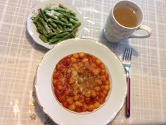 Gnocchi with tomato basil sauce with Parmesan cheese and a side of steamed asparagus. Lemon honey green tea too. :)