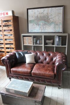 CHESTERFIELD TWO SEAT LEATHER SOFA / attic - like the look but they tend to be a bit hard to lean on.