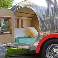 Teardrop Trailer so easy to handle, it can be hitched to a Mini Cooper.  Its standard design includes a bed, kitchen, and cabinets.