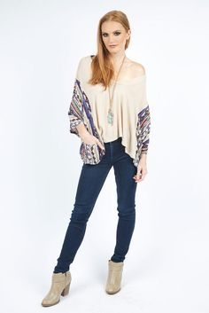 Play up your casual, cool style with our Mitra Taupe Kimono. This funky top has a wide neck that falls off the shoulder effortlessly and unique ethnic print sleeves to give it some color!