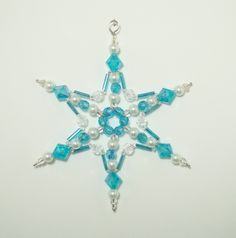 Beaded Snowflake - Aquamarine and White Pearl - Ornament - Suncatcher - Decoration. $4.50, via Etsy.