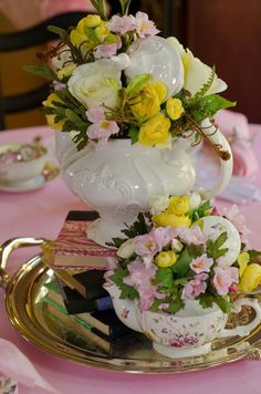 Centre piece for the tea party. I really like the fowers in the teapots, thoughts?