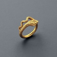 Roman Gold Ring in the shape of a serpent. Culture : Roman, Roman Imperial. Period : Roman (Egypt), 1st Century A.D. Material : Gold.