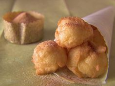 Food Network invites you to try this Zeppole recipe from Giada De Laurentiis.