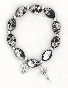 18-Inch Rhodium Plated Necklace with 6mm Garnet Birthstone Beads and Sterling Silver Our Lady the Undoer of Knots Charm.