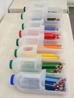 DIY: Pencil Containers.  Teachers this is a Great idea for your classrooms! Store your colored pencils, all organized in old milk containers.
