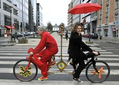 Dutch-speaking Leon Zoetebier (right) and French-speaking Franz Coquidor bicycle in opposite directions in the streets of Brussels on January 27, 2011 to highlight Belgium's problems bridging the gulf between the Dutch-speaking north and French-speaking south. (Georges Gobet/AFP/Getty Images)