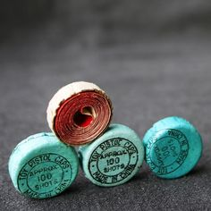 Caps from a toy cap gun!  Oh, I can still smell that lovely gunpowdery smell... (via MademoiselleChipotte on Etsy)