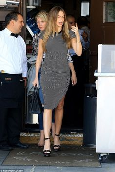 Stunning as always: Sofia Vergara looked beautiful as she showed off her famous figure in a hypnotic monochrome bodycon dress as she went for lunch at Il Pastaio in Beverly Hills on Wednesday