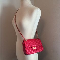 """LAST ONE!! Red quilted shoulder bag Faux leather with a turn lock closure. The inside has one zippered pouch and one open pocket. The back has one open pocket. Can be worn with one strap (18"""" handle drop) or both straps (9"""" handle drop). Bag is 8"""" long and 6.5"""" tall. Available in multiple colors in my closet!  NWT. Brand new with tags.  Availability- 1 PLEASE do not purchase this listing. Price is firm unless bundled. No trades2L9 Boutique Bags Shoulder Bags"""