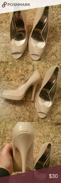 Guess nude heels Brand new, never used. Super sexy!!! Guess Shoes Heels