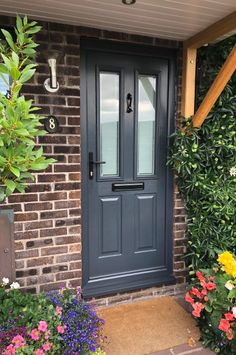 Our composite doors meet all the most stringent standards and will perform flawlessly for years to come. Composite doors will never crack, split, warp or rot and will never need repainting like a non composite door. Front Door Entrance, Exterior Front Doors, House Front Door, Front Gates, Front Porch, Grey Composite Front Door, Dark Grey Front Door, Grey Garage Doors, Garage Door Styles