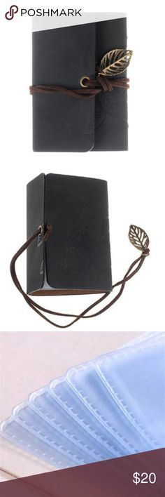 """Black Embossed Leaf Vegan Suede Card Holder Faux Suede Card Holder with a wrap around tie closure. Beautiful embossed leaf patterns on the front and the dark brown tie has a bronze gold toned leaf charm at the end. Holds 10 cards. Approximately 4"""" x 3"""" Accessories Key & Card Holders"""