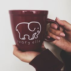 Start your day off right by sipping your morning coffee from one of our Ivory Ella Mugs! - Microwave safe - Hand-wash only - Ceramic - Holds 16 ounces Portion of each sale goes directly to savetheelep Maroon Aesthetic, Save The Elephants, Elephant Love, Elephant Mugs, Cute Mugs, Burgundy Color, Shades Of Red, Love Gifts, Mug Cup