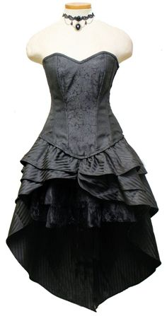 This is a two piece set. The corset and overskirt are one piece. Corset is fully steel boned with heavy duty corset lacing and side zipper. The underskirt is our Vampirella skirt- three tiered mini skirt in satin and lace.    Black Brocade Overbust Fashion Corset Dress  12 Spiral Steel Bone, 2 Flat Steel Bone  Center Front Length: 19 inch (48.26 cm). Length does not include added Vampirella skirt.  Side Length: 21.5 inch (54.61 cm)  Center Back Length: 41.5 inch…